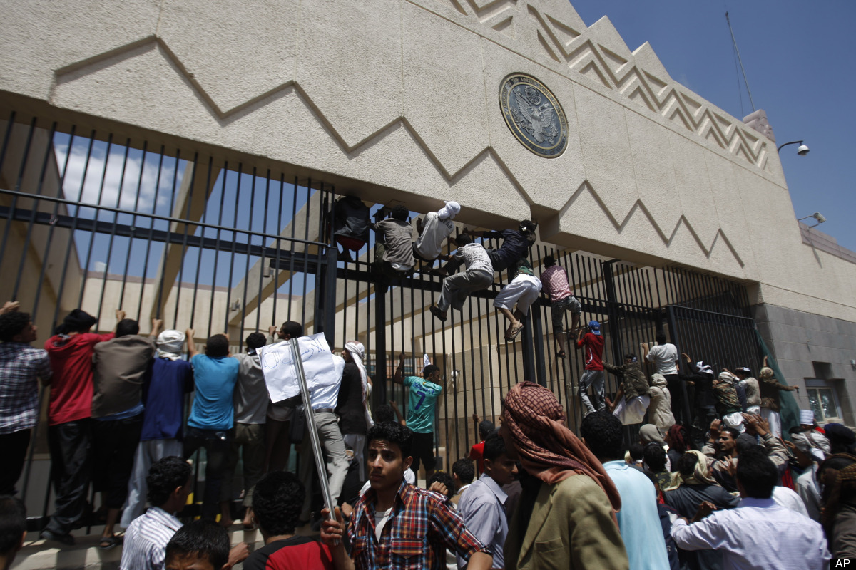 Yemeni protesters climb the gate of the U.S. Embassy during a protest about a film ridiculing Islam's Prophet Muhammad, in Sa