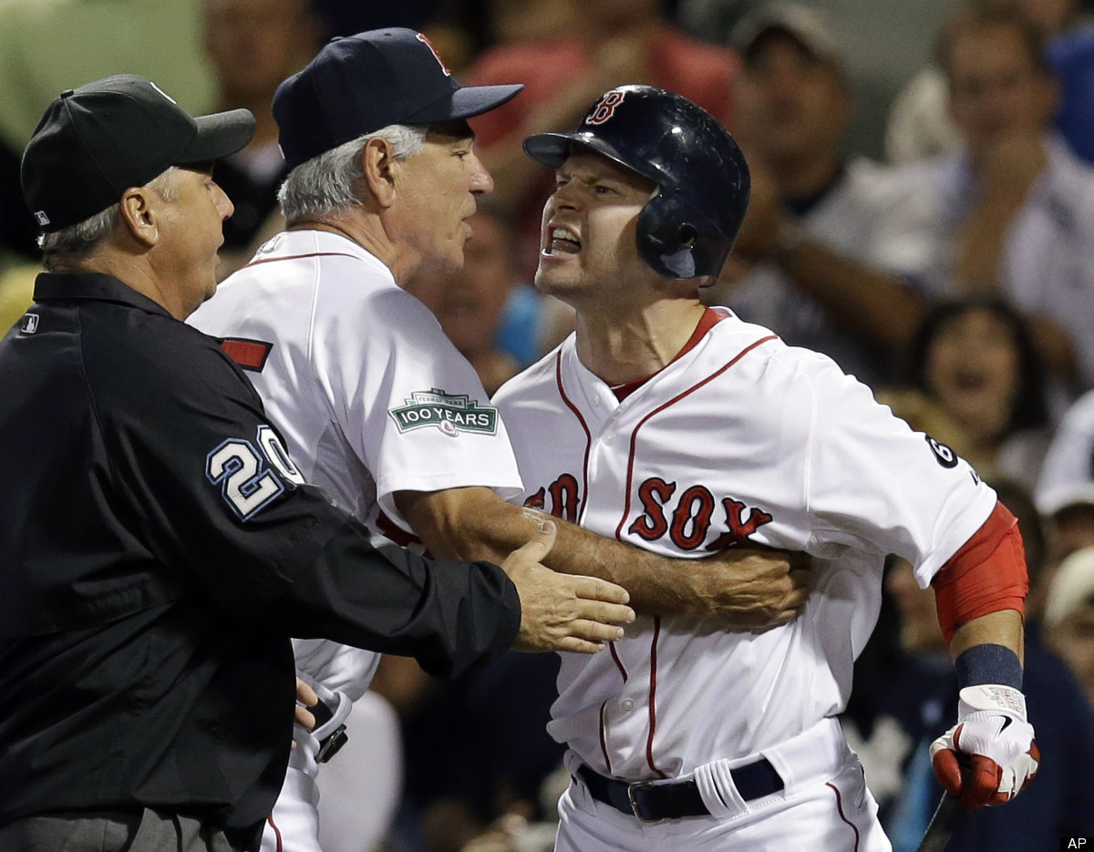 Boston Red Sox's Cody Ross, right, is held back by manager Bobby Valentine and umpire Tom Hallion (20) as he argues his calle