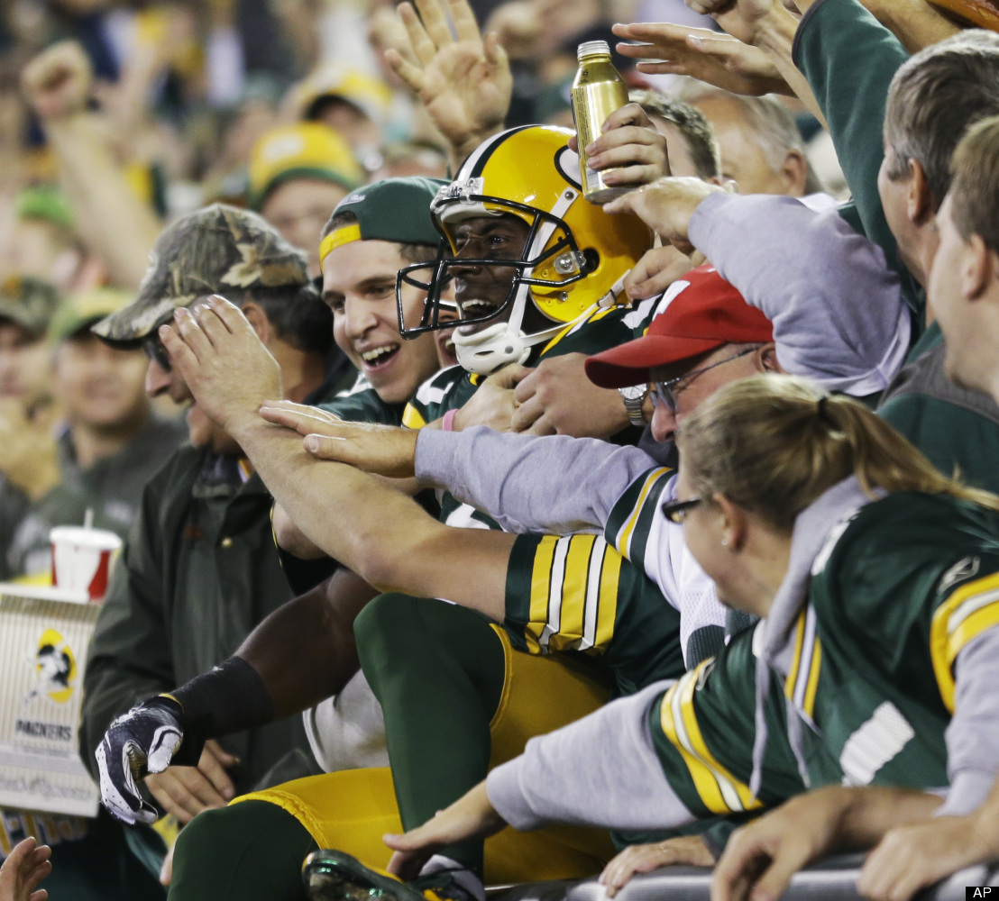 Green Bay Packers' Donald Driver celebrates with fans after catching a touchdown pass during the second half of an NFL footba