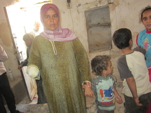 Maryam al-Sadd, 35, lost her right hand, her daughter Rama Maklluta, 5, was killed and her son, Naji, 2 years old, lost a fin