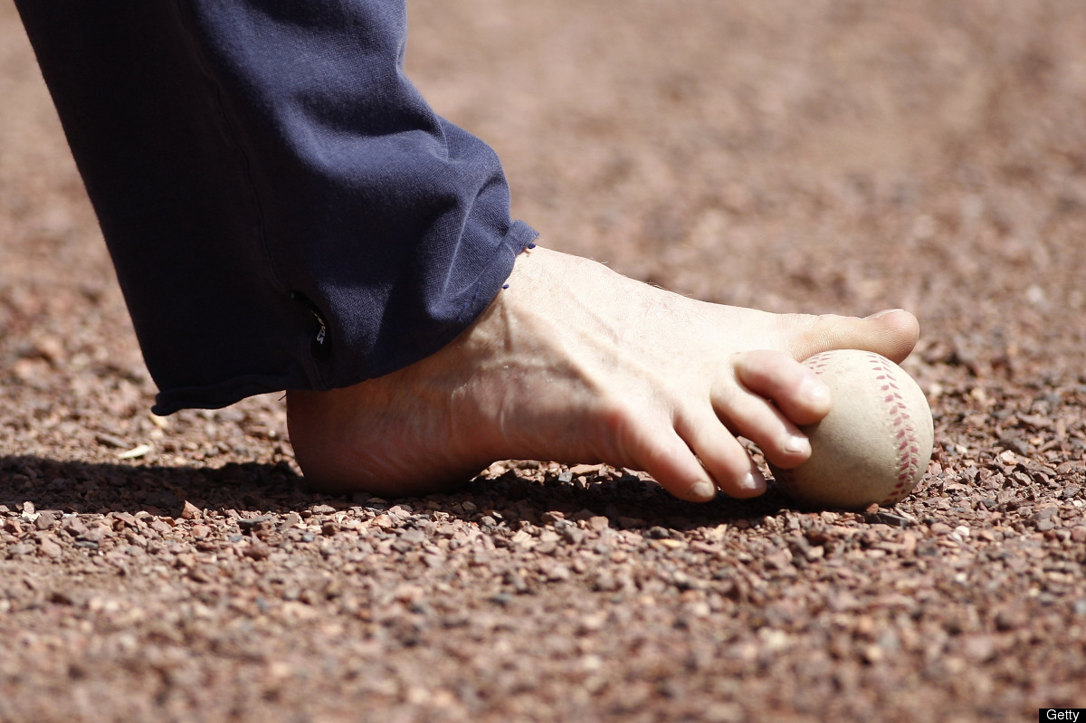 CINCINNATI, OH - AUGUST 28:  The right foot of Tom Willis prepares to deliver the ceremonial first pitch to commemorate Disab