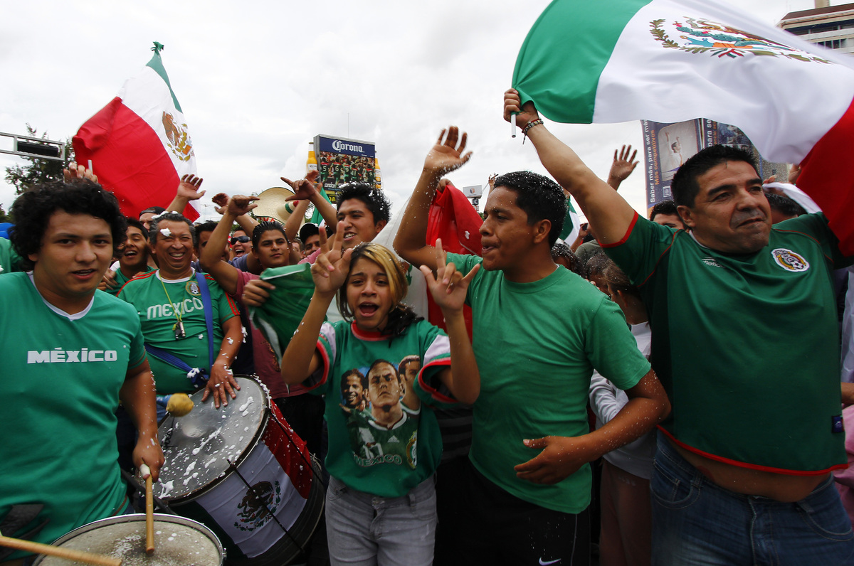 Fans of the Mexican Olympic team celebrate after Mexico won the Gold in the London 2012 Olympic Games Men's football event, i