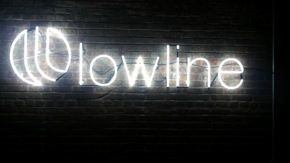 "A neon-lit sign for the <a href=""http://thelowline.org/"" target=""_hplink"">Lowline</a> greets guests as they come in. The bene"