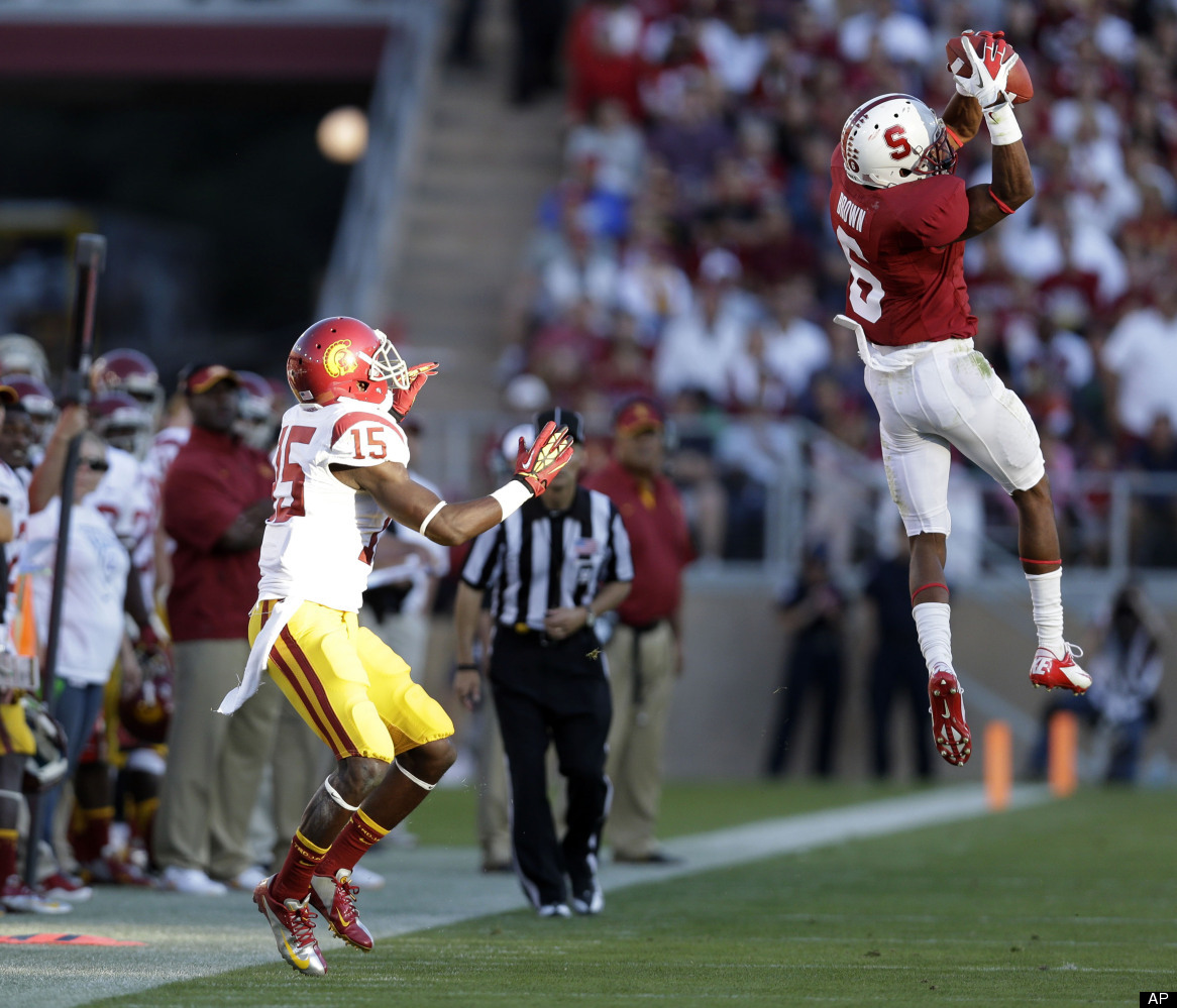 Stanford cornerback Terrence Brown, right, intercepts a pass intended for Southern California wide receiver Nelson Agholor (1