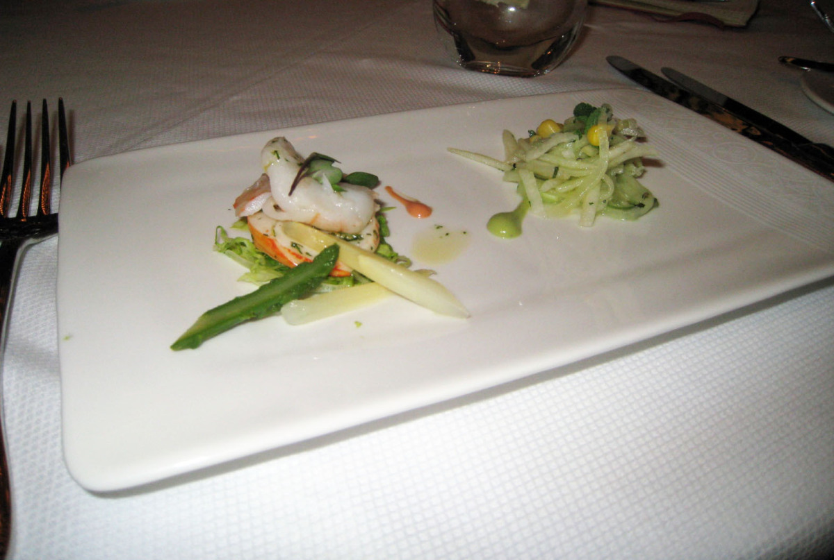 Lobster and shrimp salad from Royal Court is paired with an Asian pear salad from the Captain's Gala theme menu. Each restaur