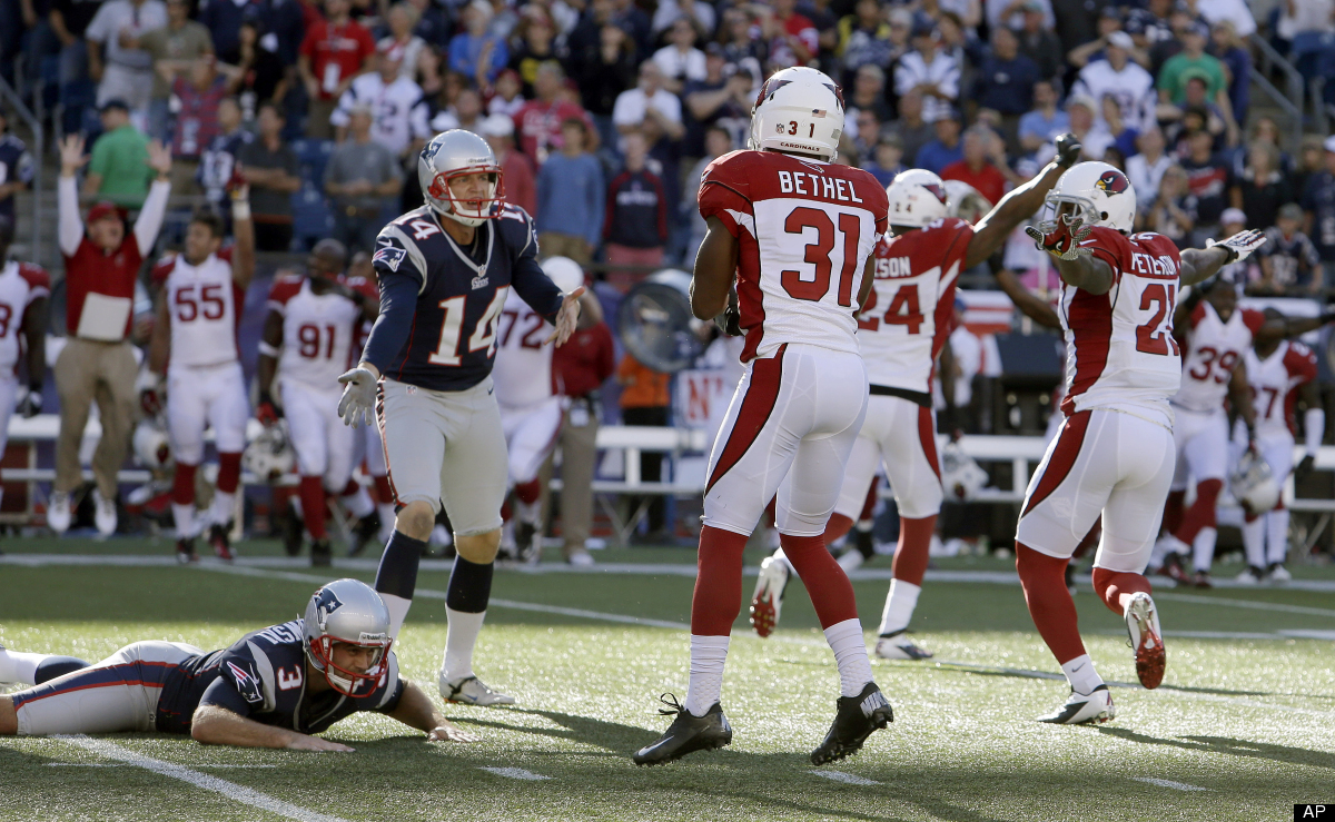 New England Patriots kicker Stephen Gostkowski (3) lies on the field alongside Arizona Cardinals cornerback Justin Bethel (31
