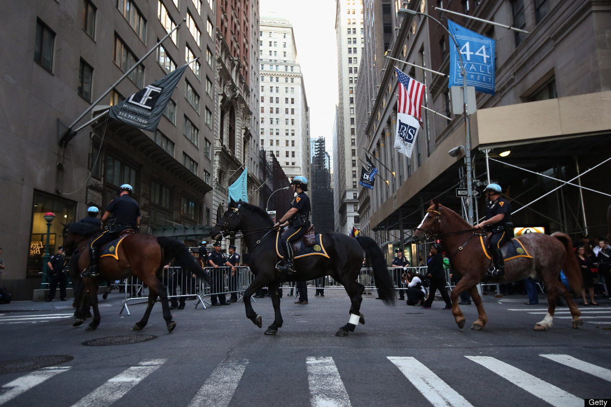 NEW YORK, NY - SEPTEMBER 17:  Mounted police pass over Wall Street during the one-year anniversary of the Occupy Wall Street
