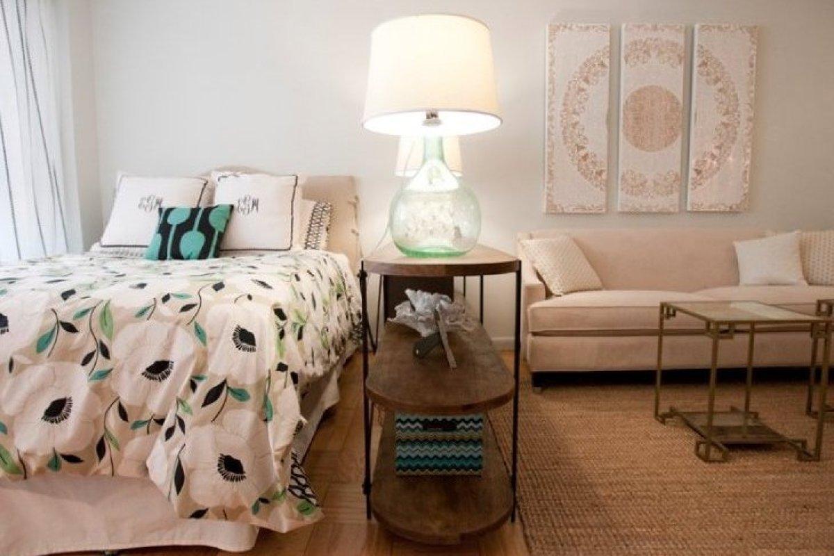 An open bookshelf divides Grunert's sleeping and living spaces.