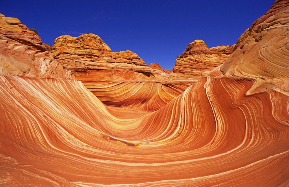 Vermillion Cliffs National Monument is a 3,000-foot escarpment that exposes seven geological formations and the sweeping flow