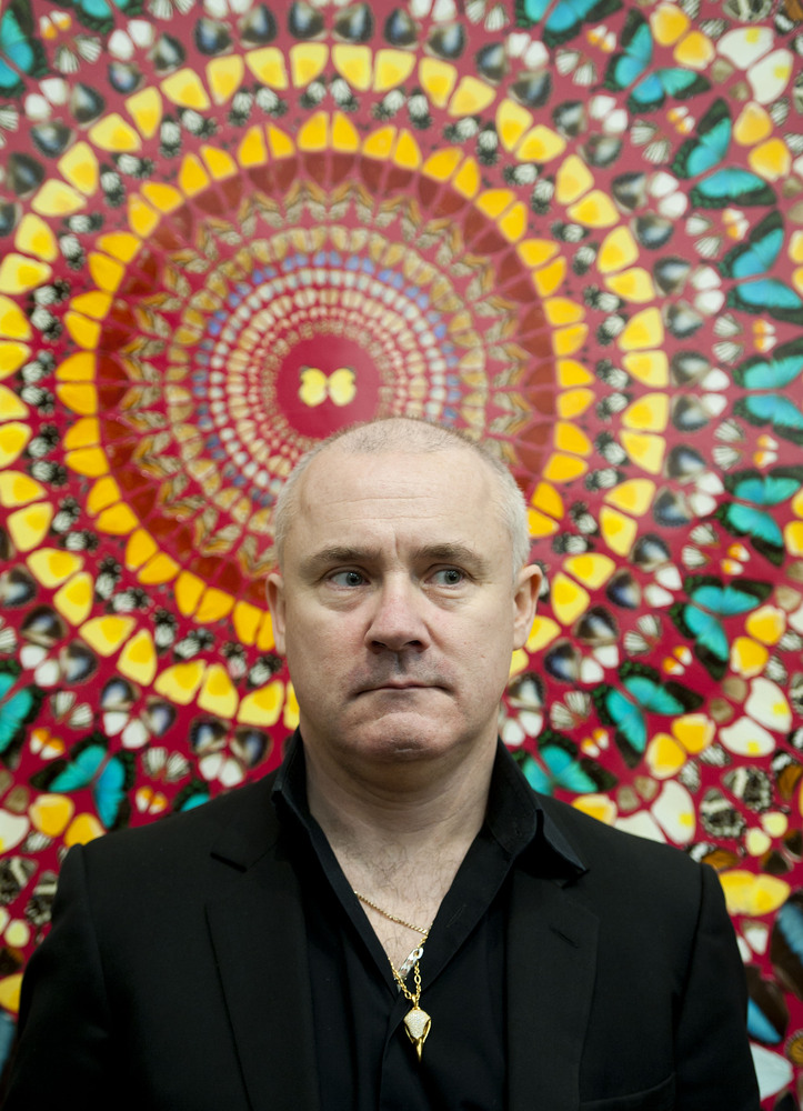 Artist Damien Hirst pictured in front of his work I Am Become Death, Shatterer of Worlds, on display at a retrospective exhib