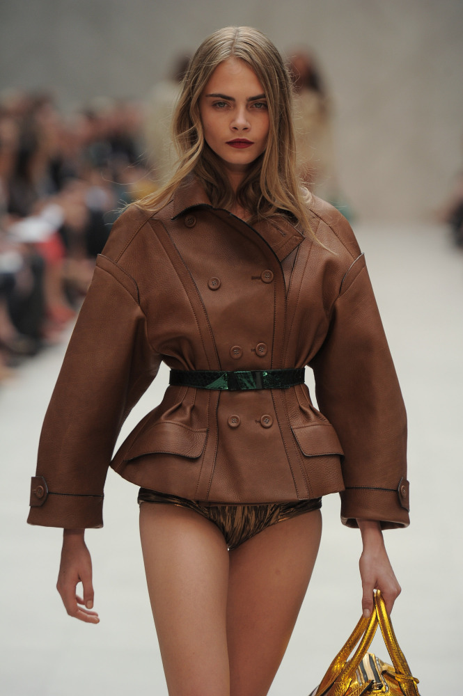 Cara Delevigne on the runway at Burberry Prorsum. September 17, 2012. Photo: Catwalking.