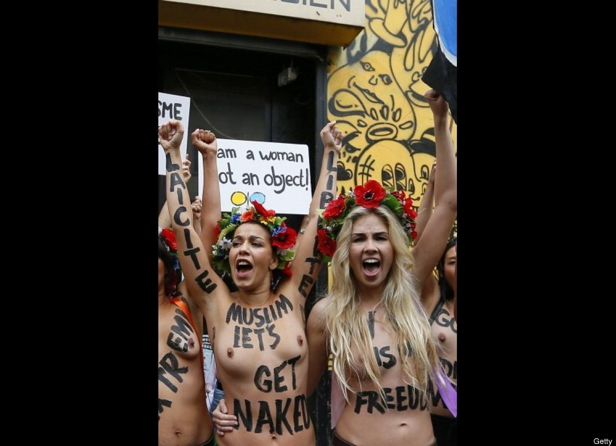 Topless activists of the Ukrainian movement FEMEN protest in front of their official Centre in Paris. (Kenzo Tribouillard/Get