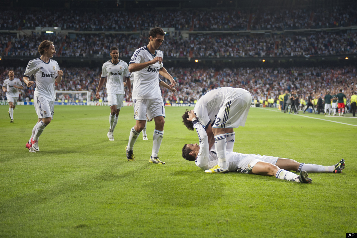 Real Madrid's Cristiano Ronaldo from Portugal, down, celebrates with Marcelo from Brazil after scoring a goal against Manches