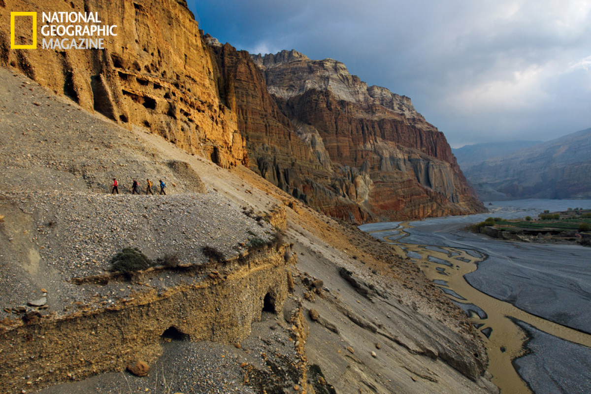 Climbers and scientists follow a trail above the Kali Gandaki River in Nepal's remote Mustang region. More than 60 feet above