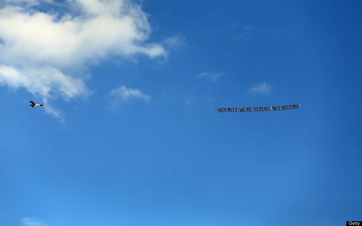 MIAMI, FL - SEPTEMBER 19: A banner plane flies above the University of Miami carrying a sign reading 'Hey Mitt, We're Voters,