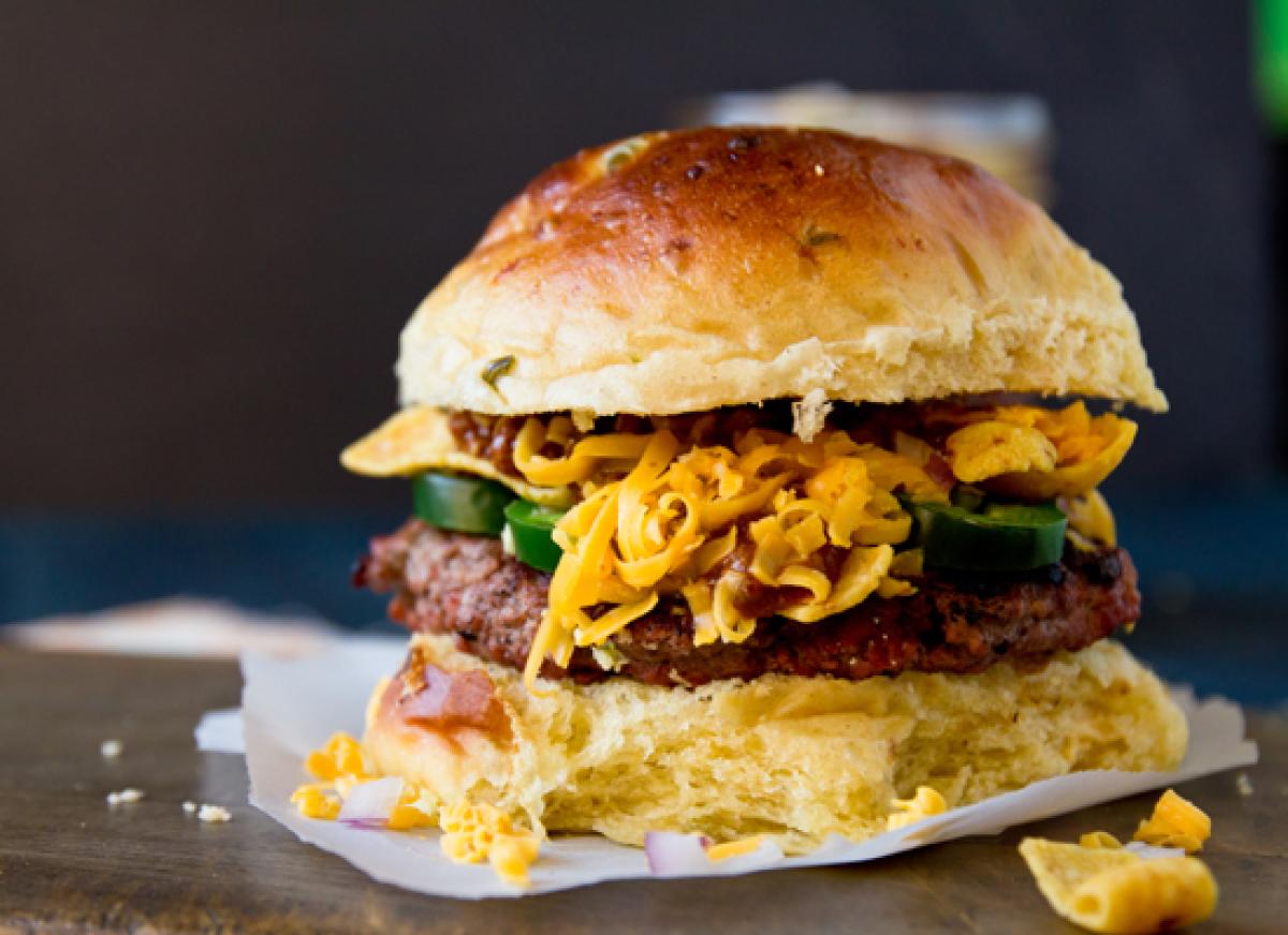 "<strong>Get the <a href=""http://www.jasonandshawnda.com/foodiebride/archives/11505/"" target=""_hplink"">Frito Pie Burger recipe"