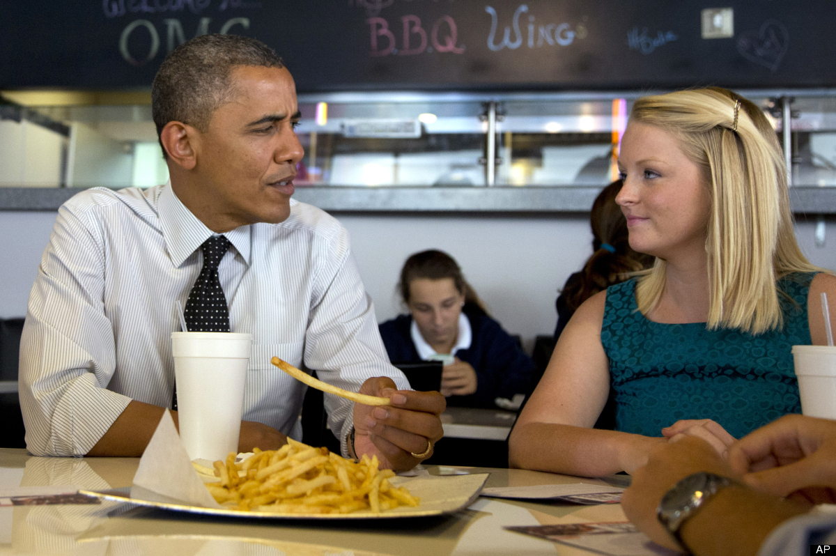 President Barack Obama visits Emily Young, first time voter, and student and University of Miami at OMG Burger, Thursday, Sep