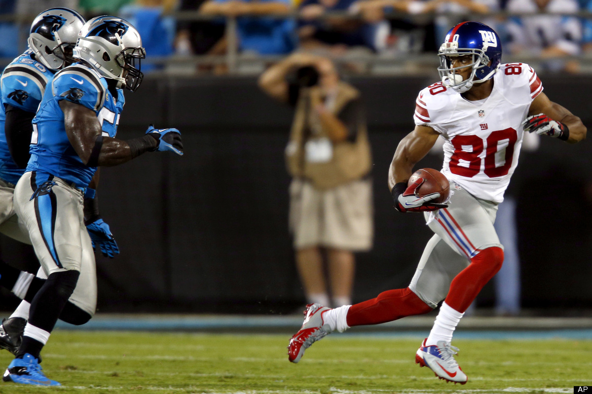 New York Giants wide receiver Victor Cruz (80) runs after a catch as Carolina Panthers linebackers Jon Beason (52) and James