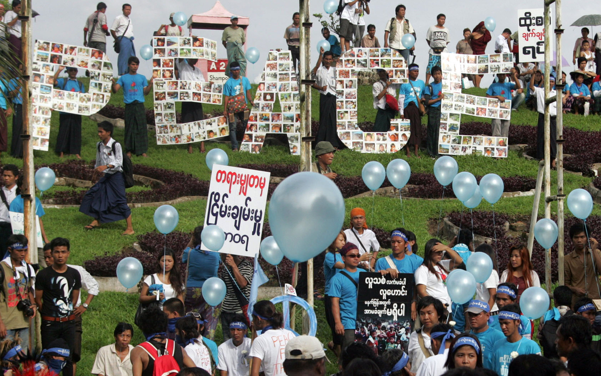 Participants gather to mark the International Day of Peace in Yangon, Myanmar, Friday, Sept. 21, 2012. They pray for a cease-