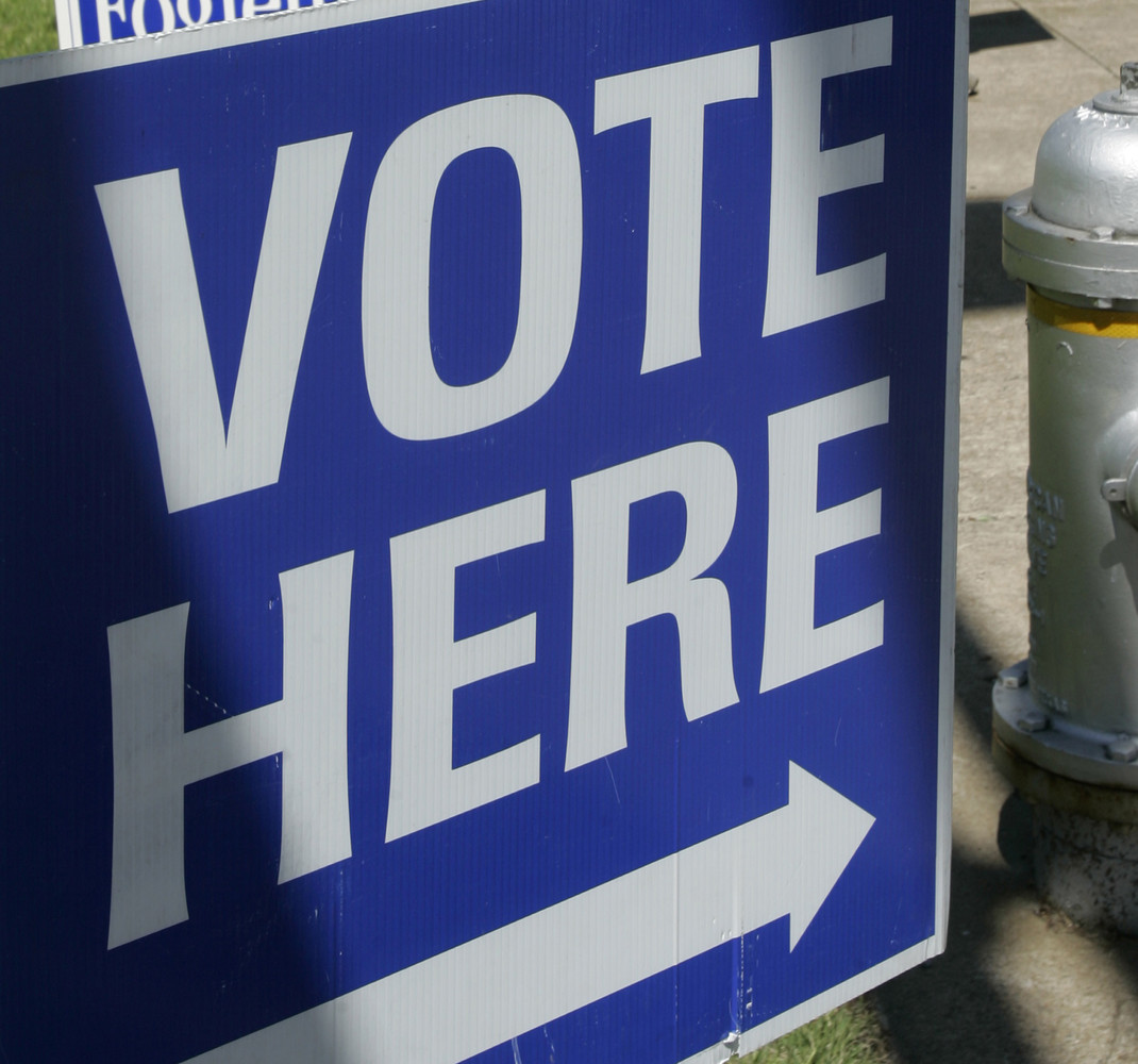"This May 3, 2010 photo shows a ""vote here"" sign near a polling place open for early voting in downtown Little Rock, Ark. (AP"