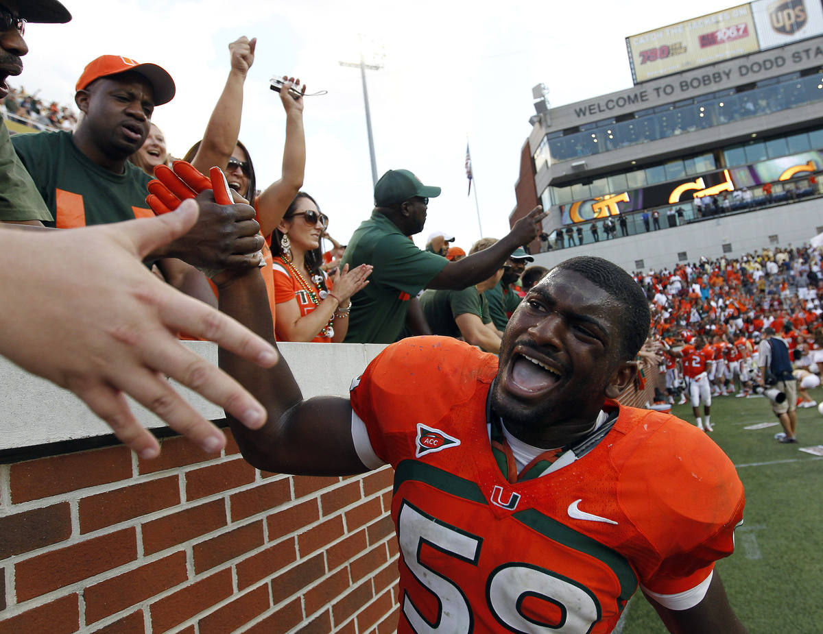 Miami linebacker Jimmy Gaines (59) celebrates the Hurricanes' 42-36 overtime win over Georgia Tech in an NCAA college footbal