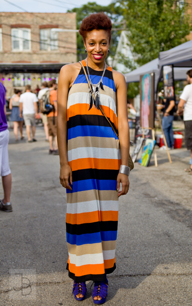 <em>Hook-worthy:</em>  multi-colored maxi dress, feather and silver necklace, silver fish scales bangle, and cobalt platforms