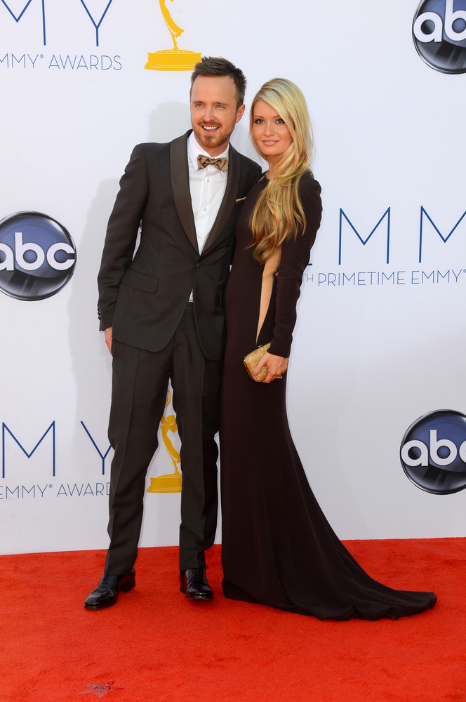 LOS ANGELES, CA - SEPTEMBER 23:  Actor Aaron Paul (L) and Lauren Parsekian arrive at the 64th Annual Primetime Emmy Awards at