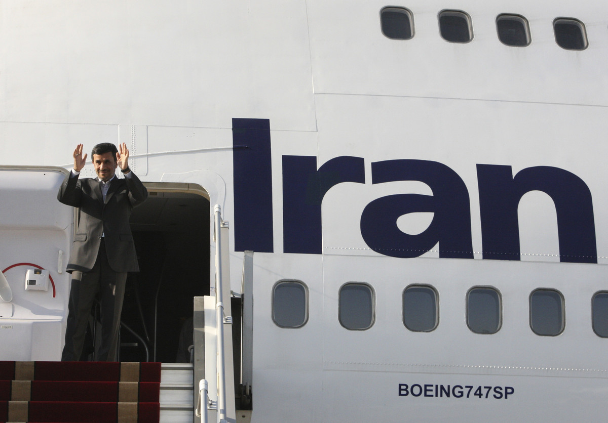 In this Monday, Sept. 19, 2012 file photo, Iranian President Mahmoud Ahmadinejad waves to media an officials, as he boards hi