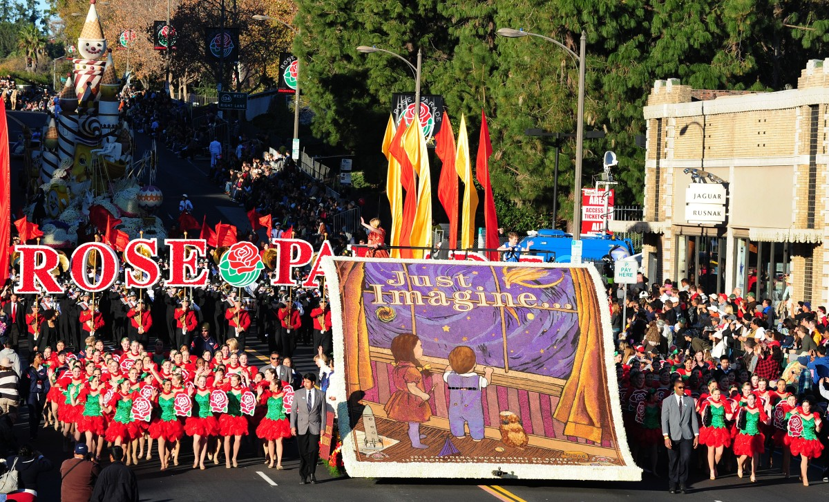 Participants march beside the theme for the annual Tournament of Roses Parade in Pasadena on January 2, 2012 in California. F
