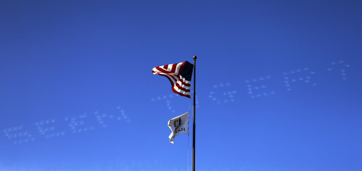 A skywriter message about USA's Tiger Woods is seen over the clubhouse during a foursomes match at the Ryder Cup PGA golf tou