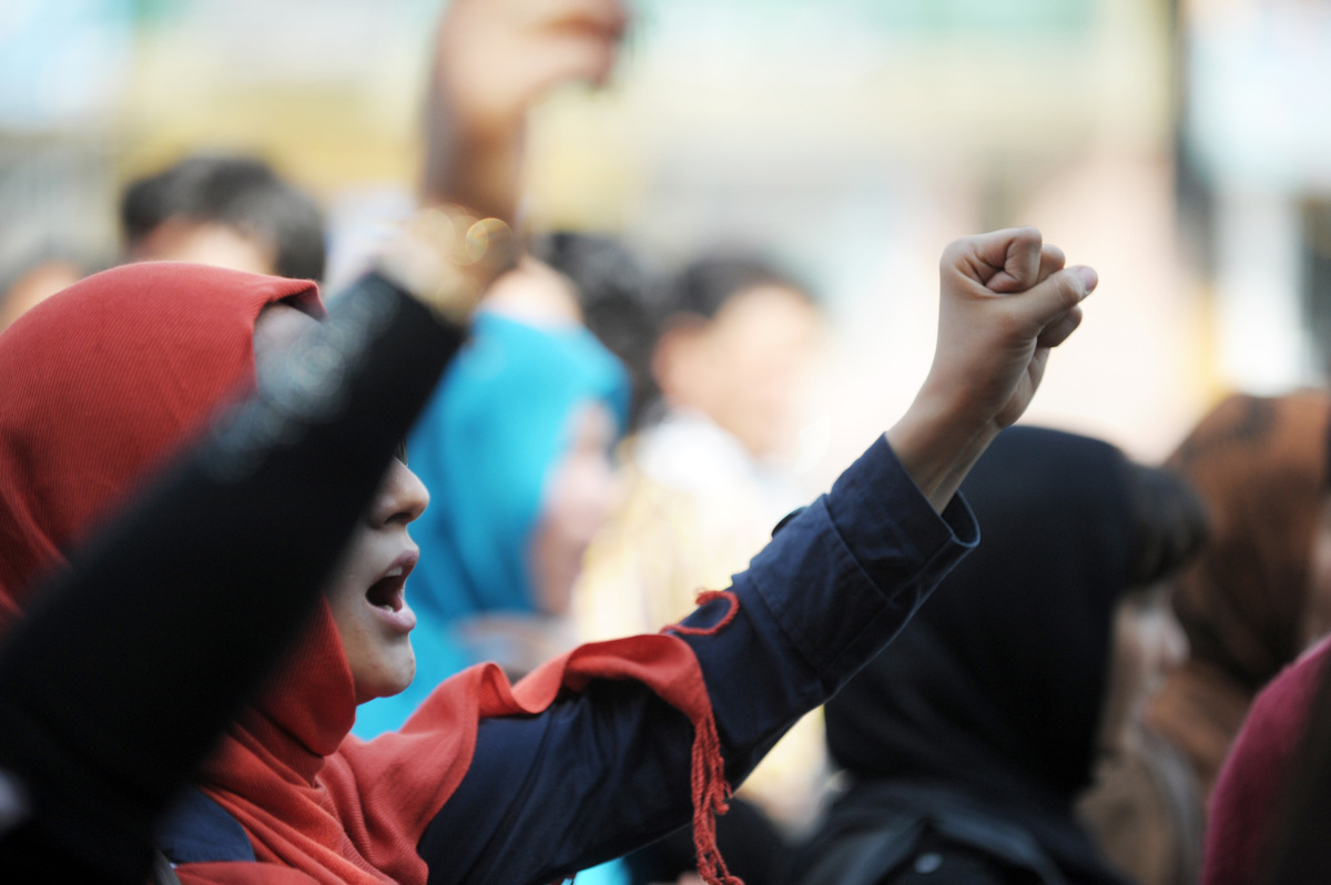 Women shout during a march to denounce violence against women in Kabul, on September 24, 2012. (ROBERTO SCHMIDT/AFP/GettyImag
