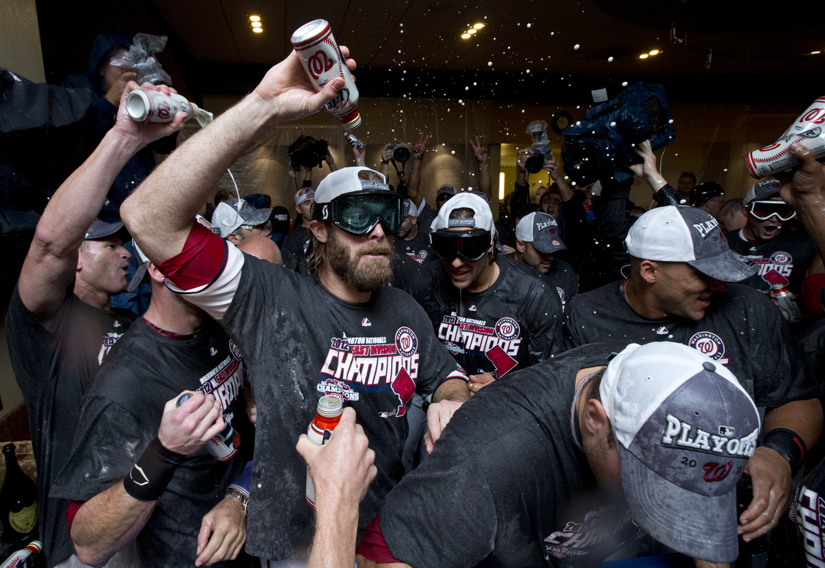 Washington Nationals right fielder Jayson Werth, center, celebrates with teammates after clutching the National League East d