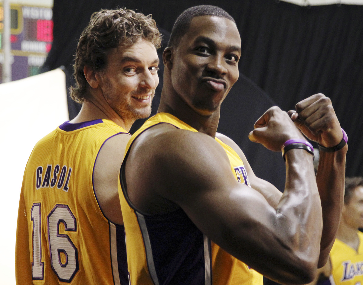 Los Angeles Lakers forward Pau Gasol (16) and center Dwight Howard pose during their NBA basketball media day at the team's h
