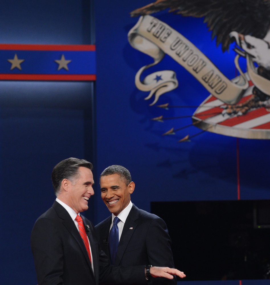 US President Barack Obama (R) greets Republican presidential candidate Mitt Romney (L) following the first presidential debat