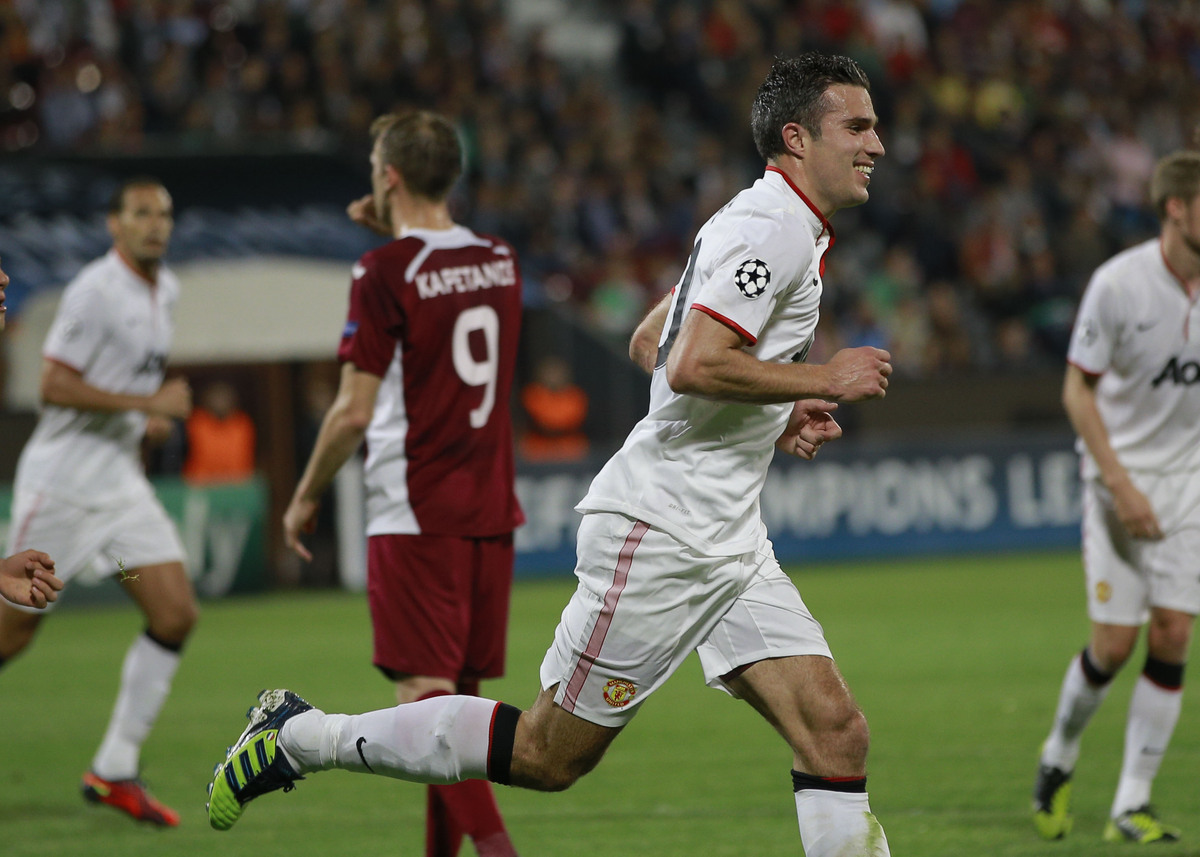 Manchester United's Robin van Persie, right, celebrates scoring an equalizer against CFR Cluj in Cluj, Romania, Tuesday, Oct.