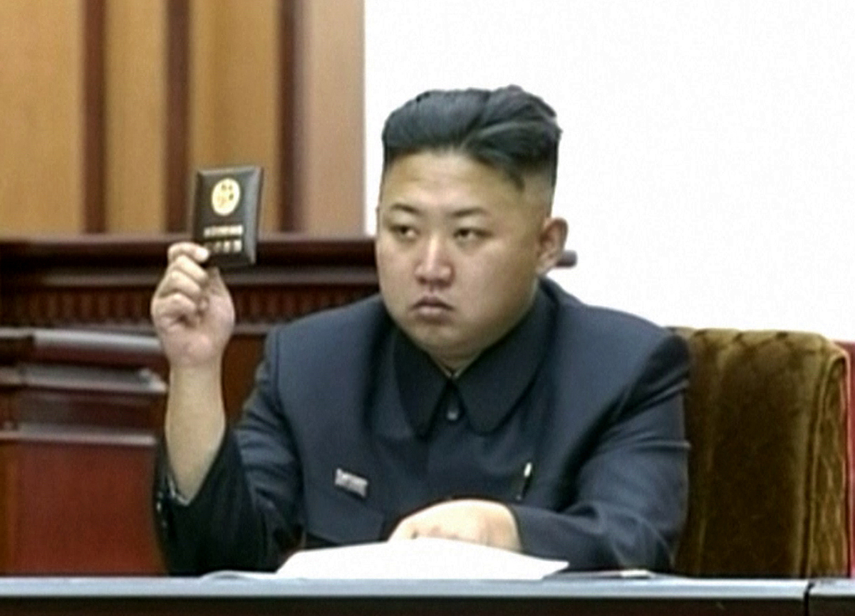 In this video image taken from KRT, North Korean leader Kim Jong Un holds up his credential at the Supreme People's Assembly'