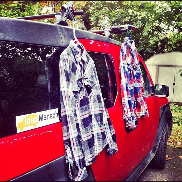 The Idea Mensch team had to get creative while traveling. Here, shirts are shown drying on the side of their trusty car, 'Ell