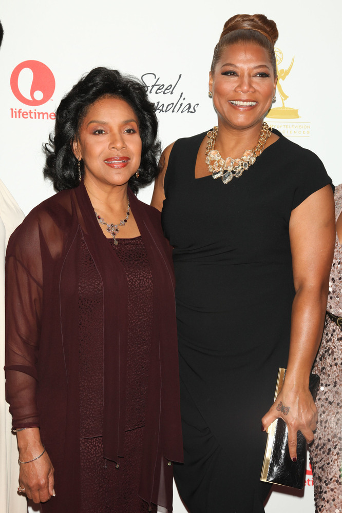 This image released by Starpix shows actresses Phylicia Rashad, left, and Queen Latifah at the world premiere of their TV fil