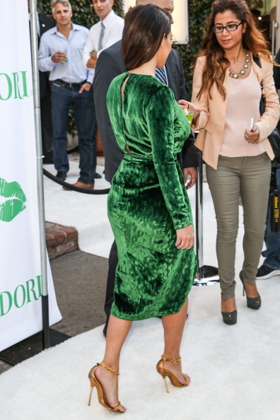 Kim Kardashian looked absolutely bootylicious in a green velvet Gucci dress at a Midori Makeover Party on September 25th but