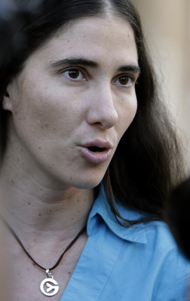 FILE.- In this March 30, 2011 file photo, Cuban dissident writer Yoani Sanchez speaks with journalists after meeting with for