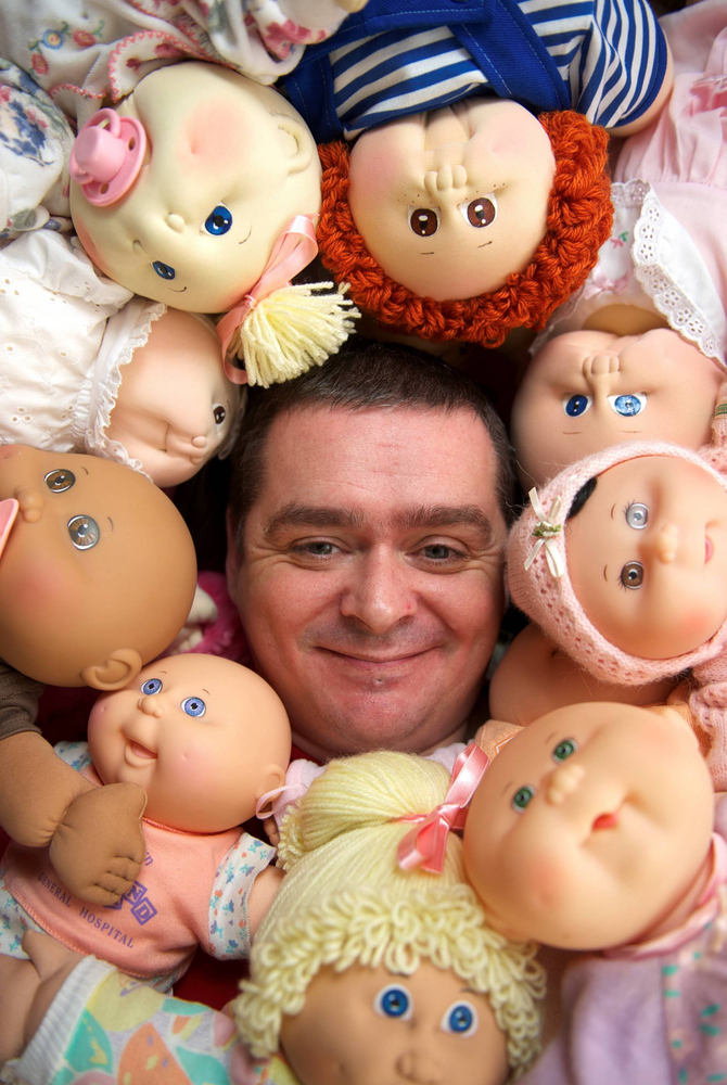 Dan Knowlton surrounded by his collection of Cabbage Patch Kids dolls.  An avid Cabbage Patch Kids fan has dedicated three ro