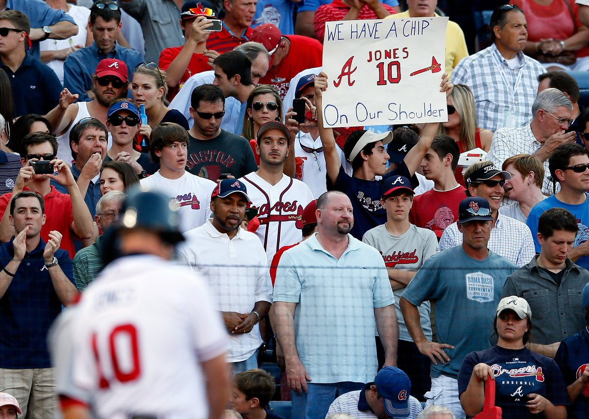 A sign is seen as Chipper Jones #10 of the Atlanta Braves is at bat in the third inning against the St. Louis Cardinals durin