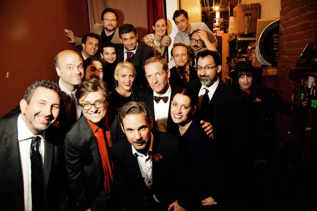 <em>From left to right, front to back</em> Craig Cackowski, James Urbaniak, Paul F. Tompkins, Paget Brewster, Scott Adsit, Ha