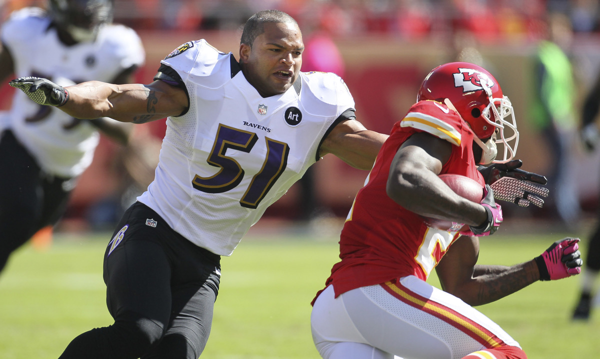 Baltimore Ravens linebacker Brendon Ayanbadejo (51) tackles Kansas City Chiefs defensive back Javier Arenas (21) during the f
