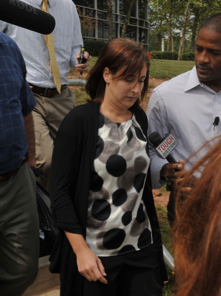August 23, 2012 DECATUR Andrea Sneiderman walks out of the Dekalb County Jail Thursday, Aug. 23, 2012 in Decatur, Ga. after p