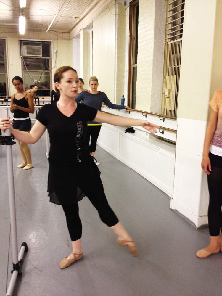 Instructor Jessica Kilpatrick demonstrates a tendu for a barre exercise.