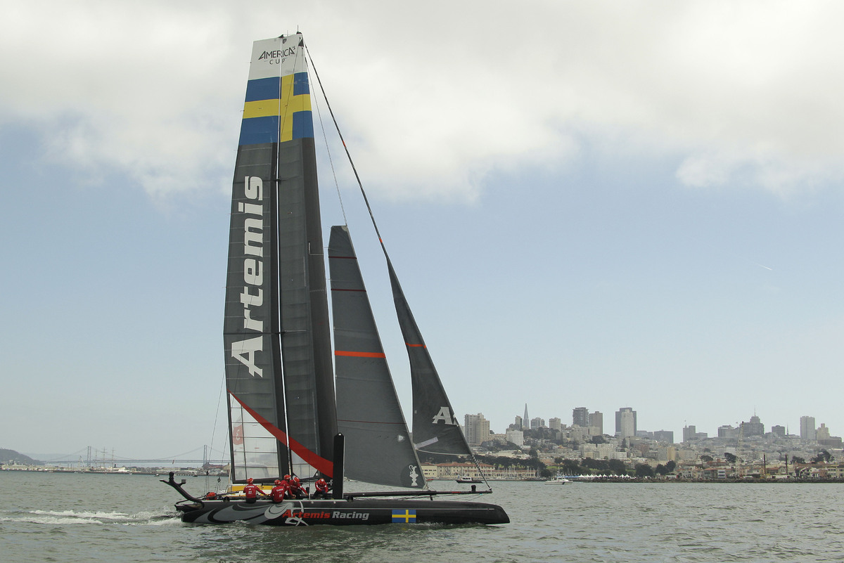 Artemis Racing White of Sweden makes its way past the San Francisco skyline while racing against Team Korea during a quarterf