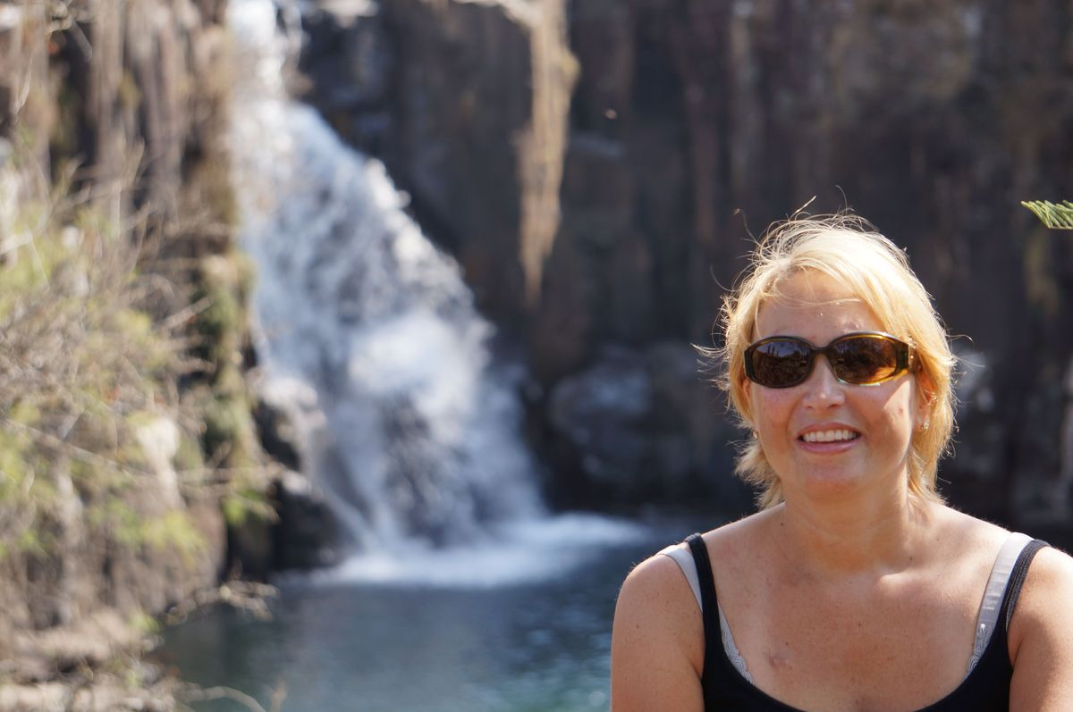 Me sitting in front of a water fall in Sani Pass, South Africa, one month ago.