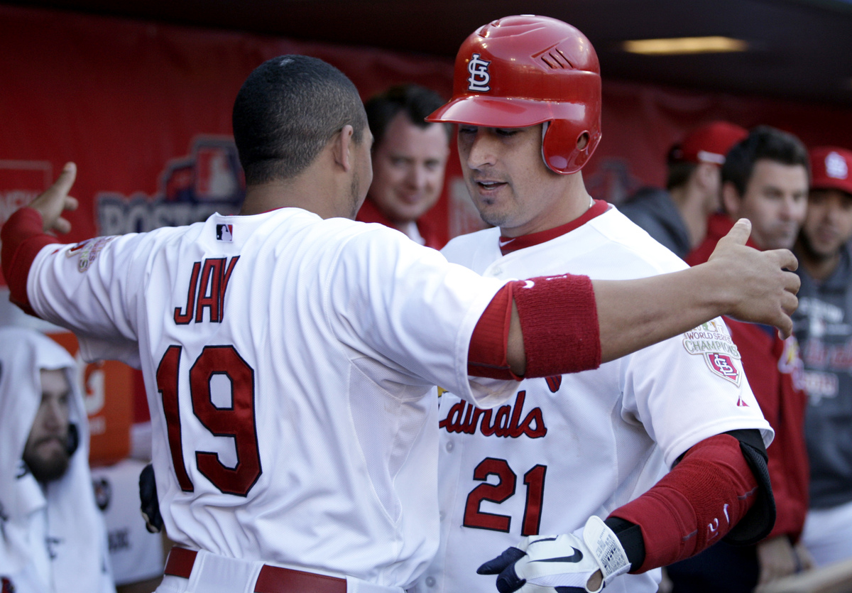 St. Louis Cardinals' Allen Craig, right, gets a hug from teammate Jon Jay after hitting a solo home run during the third inni