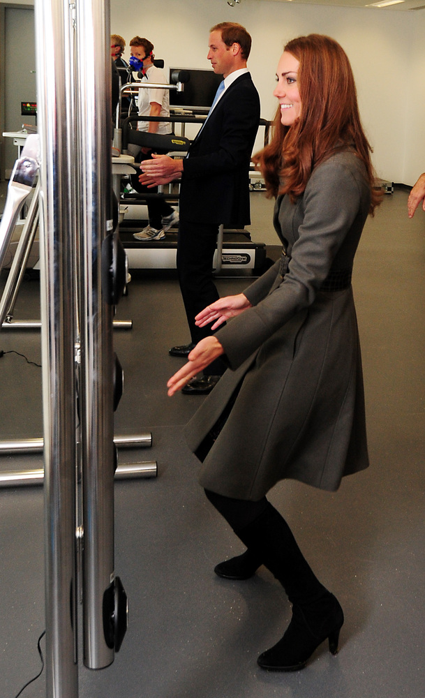 The Duke and Duchess of Cambridge play a reaction game in the new gym during the official launch of The Football Association&